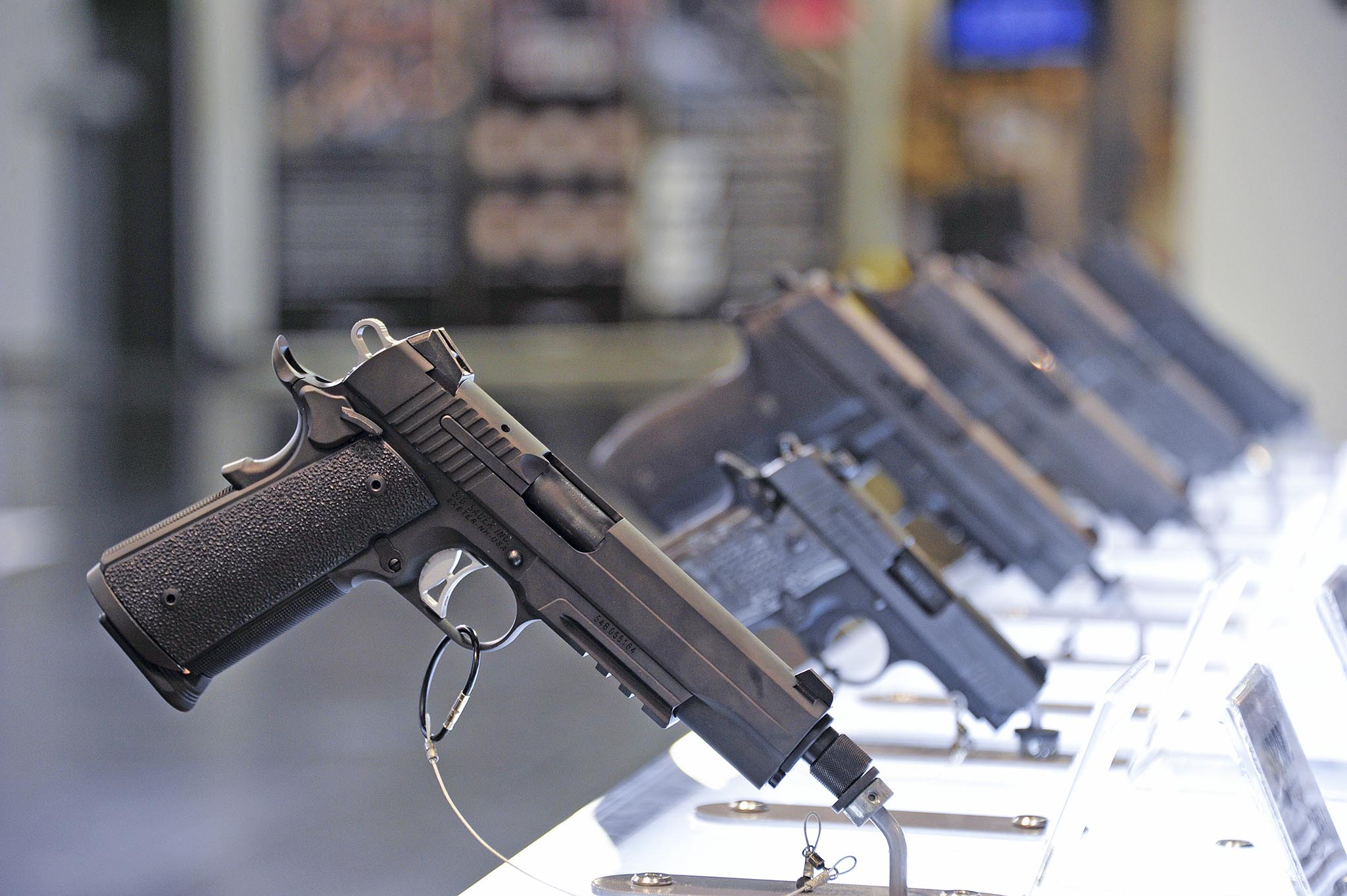 Professional handguns at Sig Sauer booth, Enforcetac 2016