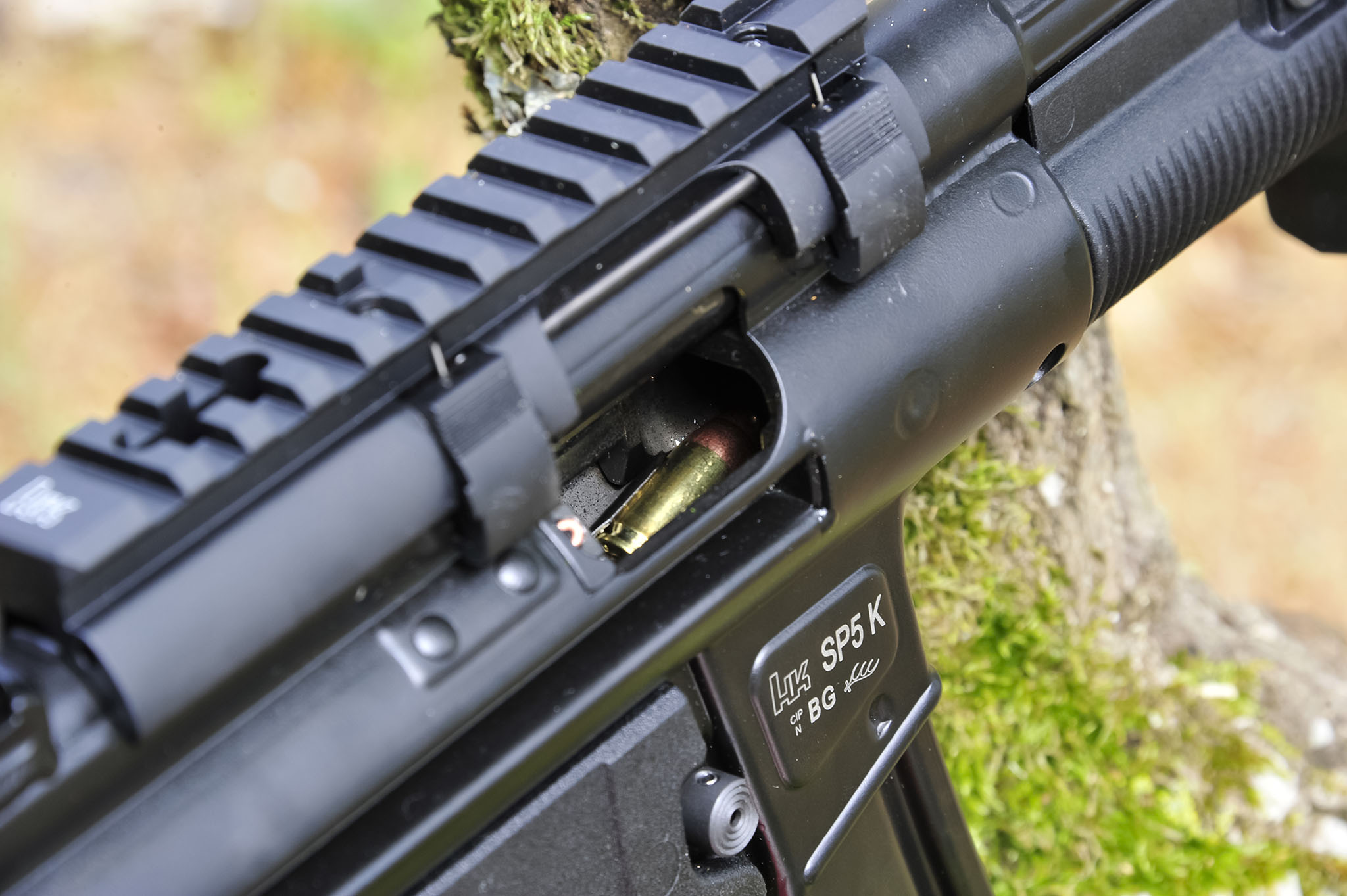 Claw-mount Picatinny optics rail mounted on a Heckler & Koch SP5K pistol