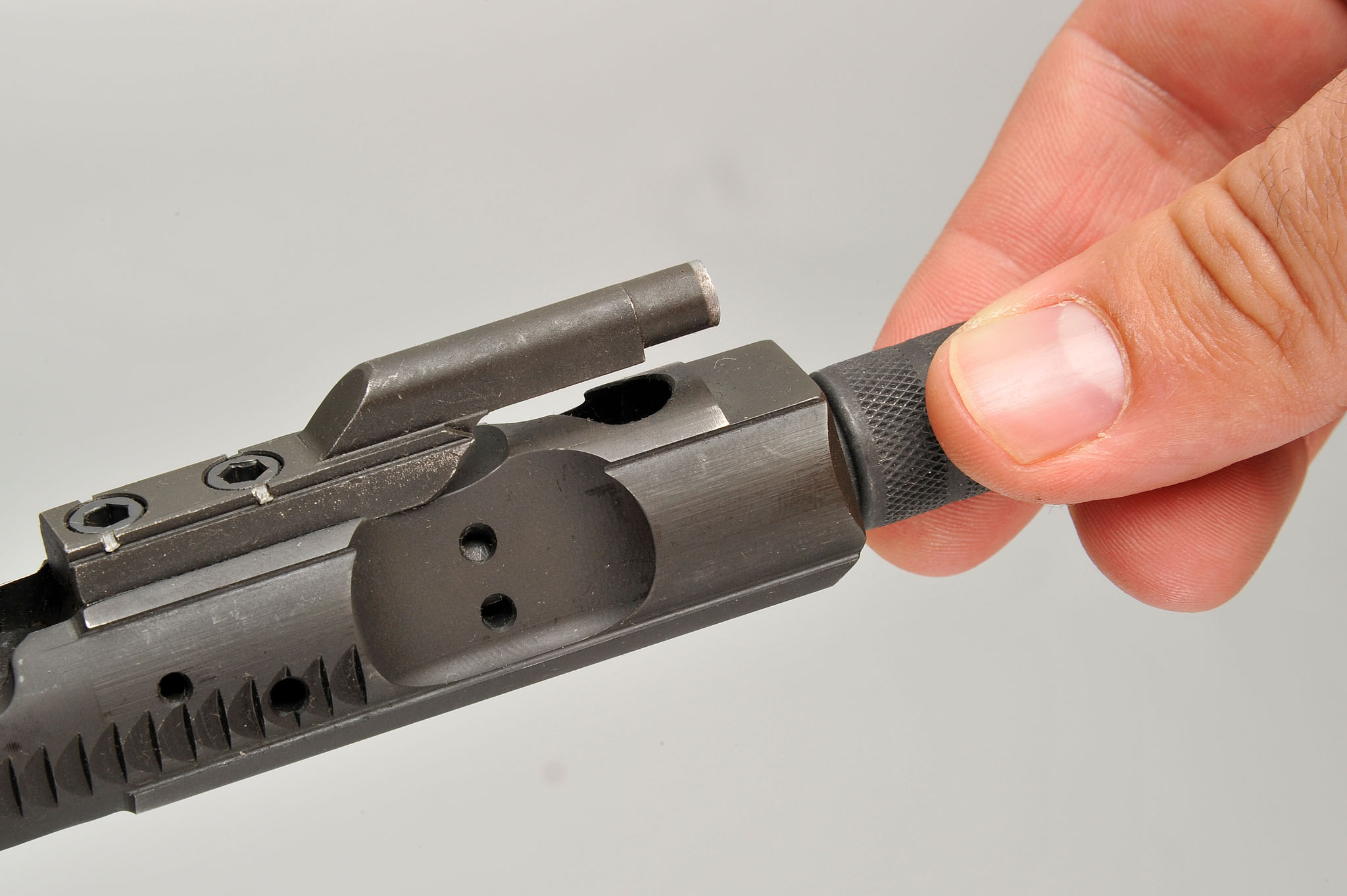 Cleaning the bolt carrier recess is a breeze: just insert the B.O.N.E. and twist