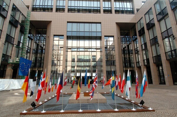 The courtyard with flags in the Justus Lipsius building in Brussels, home of the Council of the European Union