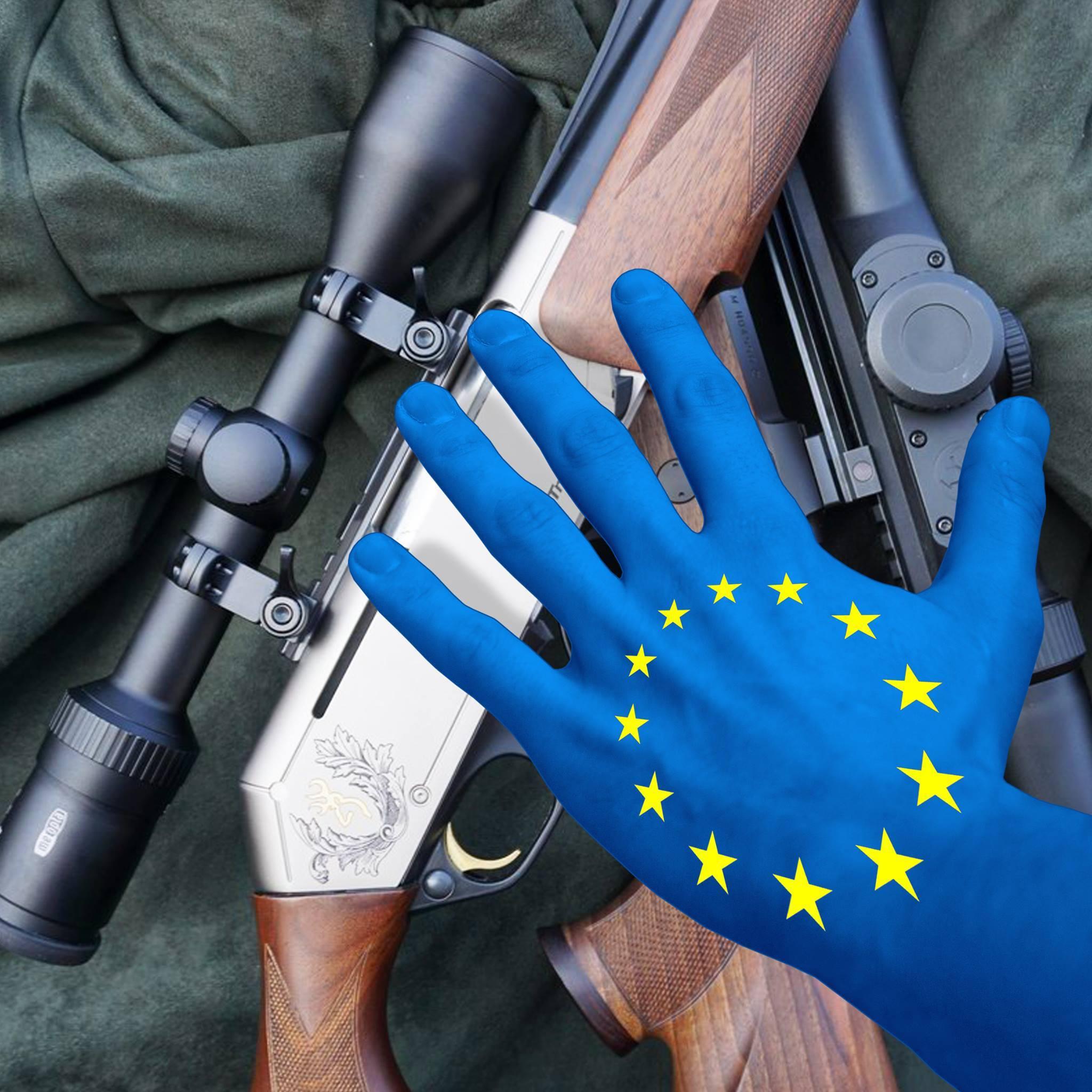 A hand grabs rifles: EU gun ban