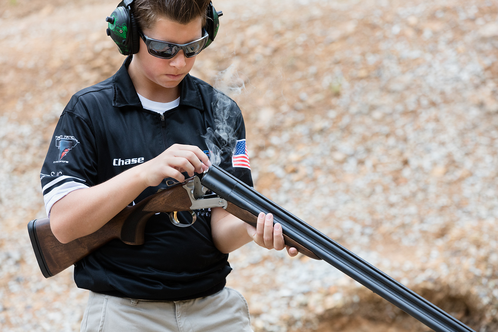 Young shooter holds a 20-gauge Chiappa Triple Threat shotgun