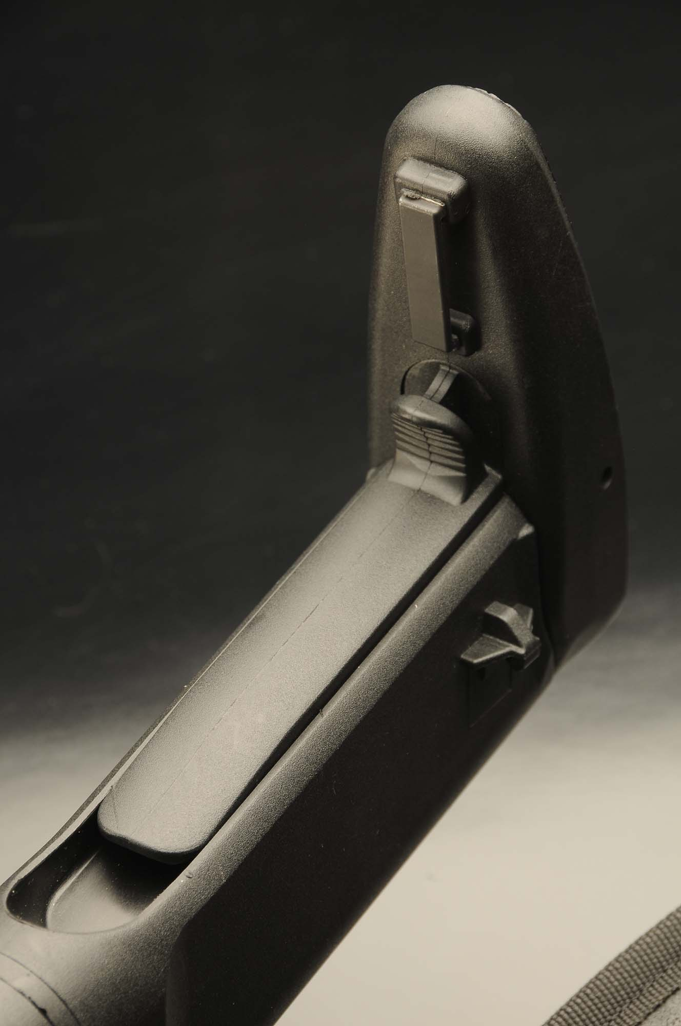 Detail of the lever that allows extension of the stock's butt pad