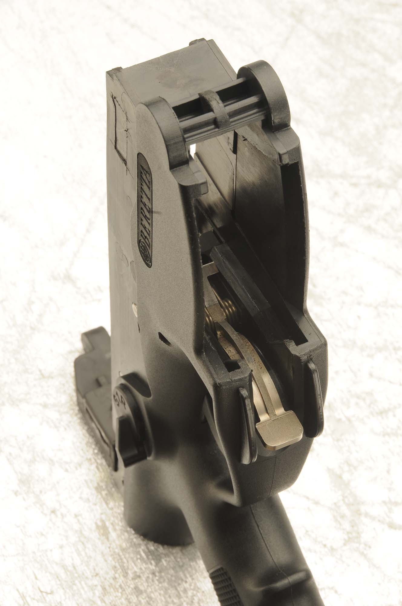 Details of the new Lower Receiver, with redesigned magazine well and the new lever magazine retention and release system