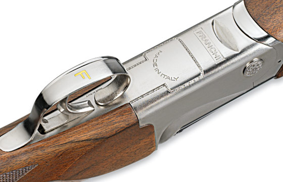 The lightweight alloy receiver houses a distinctive trigger and trigger guard displaying the gold-inlaid Franchi logo