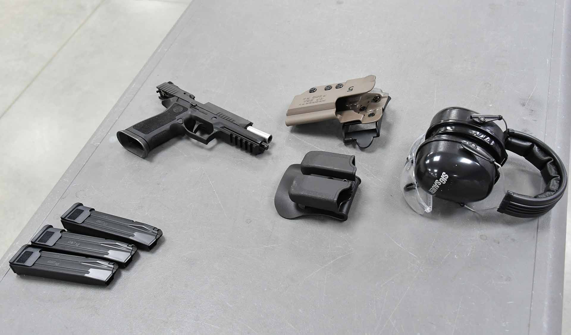 SIG Sauer P320 X5 9mm pistol, three magazines, hearing and eye protection, a holter and mag holder