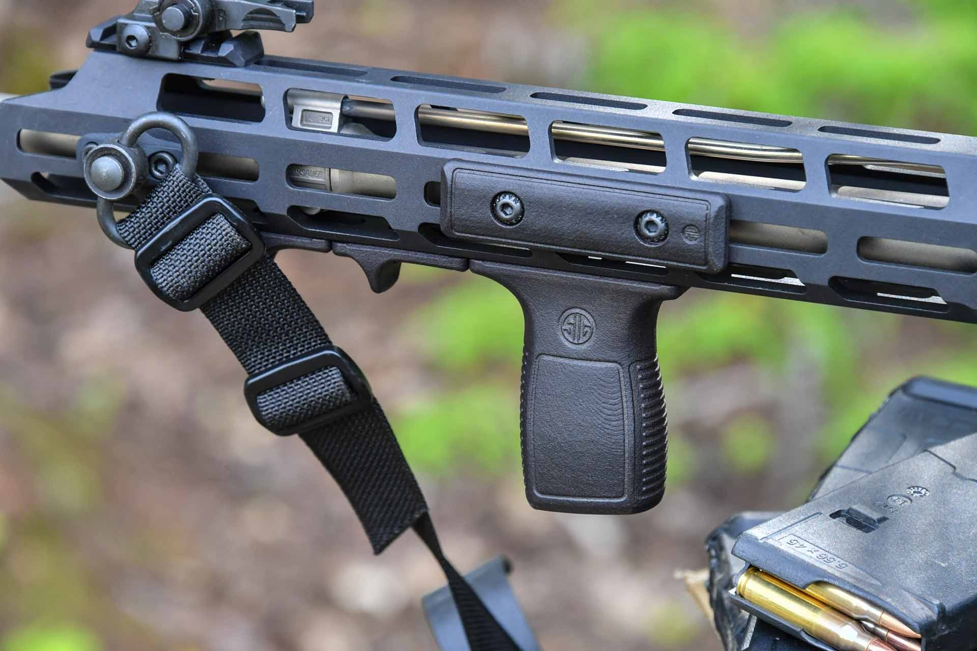 The optional vertical foregrip of the SIG Sauer M400 TREAD