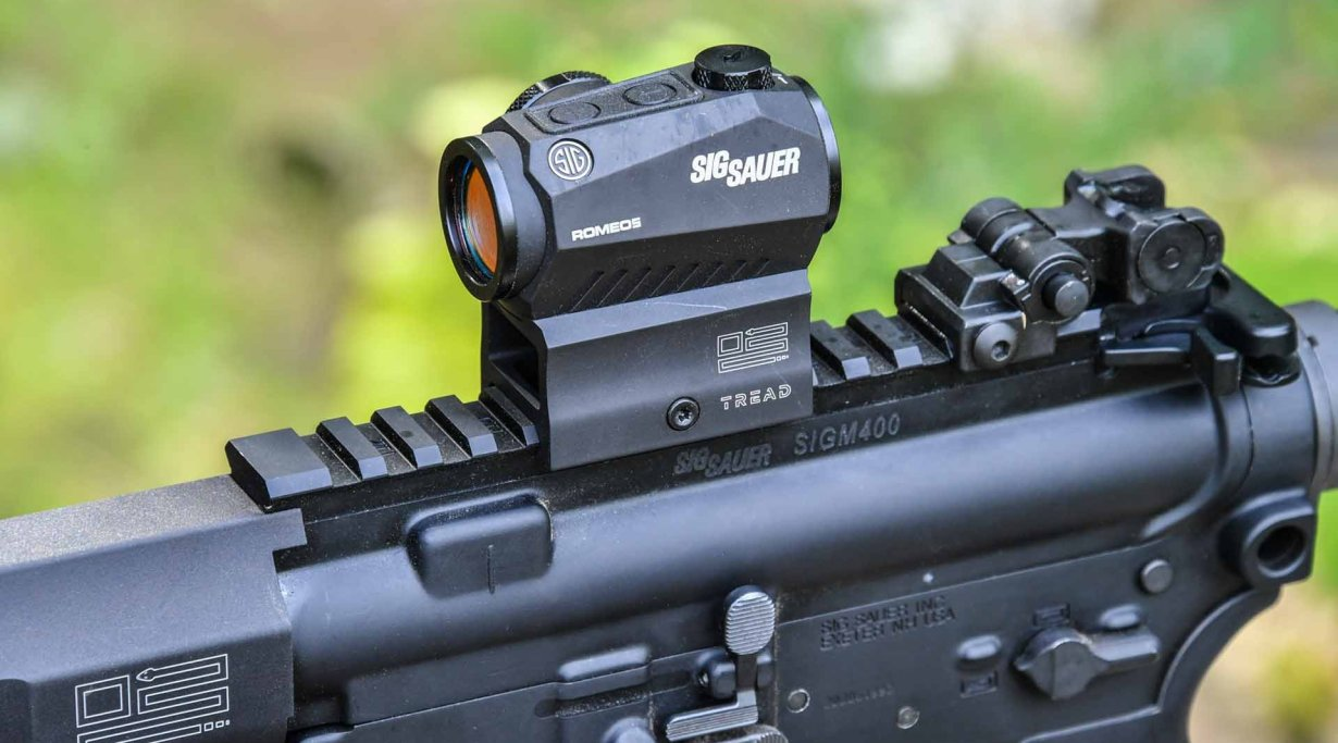 The SIG Sauer M400 TREAD rifle with a 2 MOA Red Dot optic mounted.