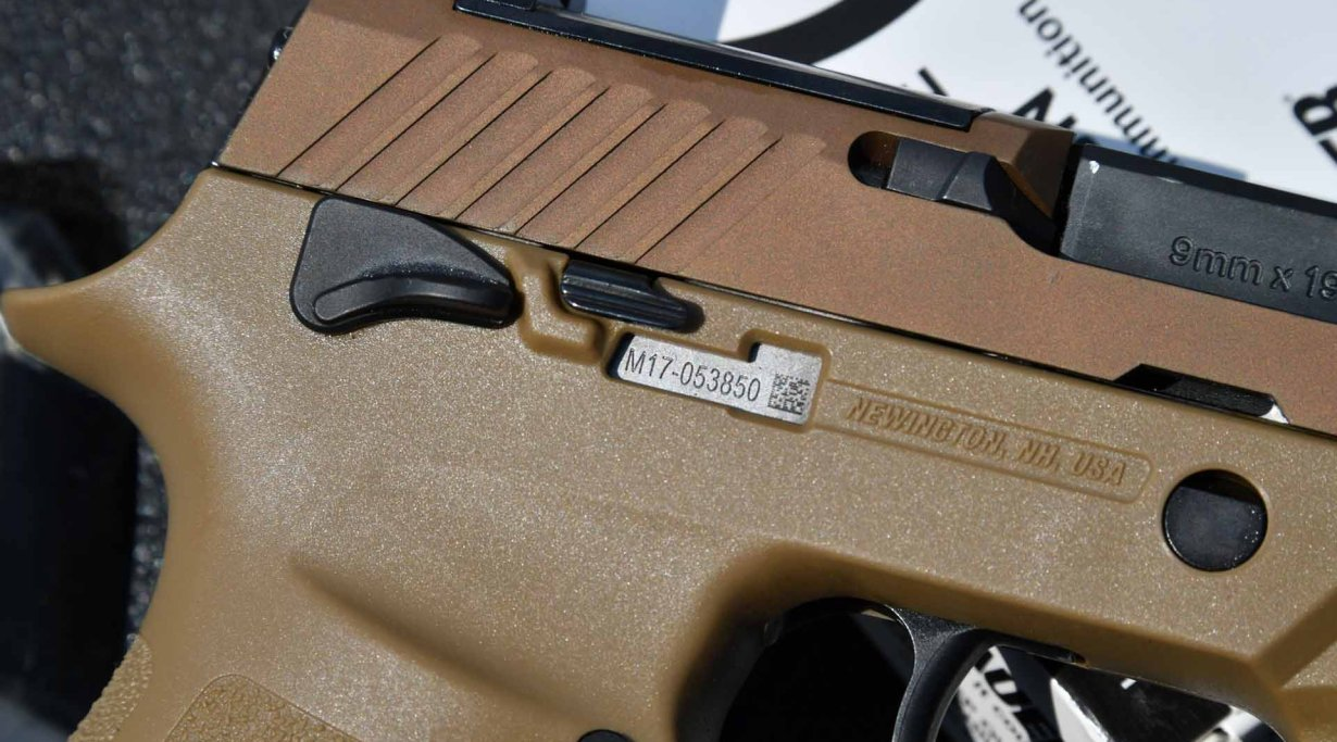 Detail of the serial number window on the grip of SIG Sauer P320 M17
