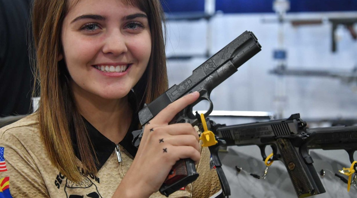 "Young girl prodigy Danyela D'Angelo with Auto Ordnance WWII themed ""Victory Girls"" 1911"