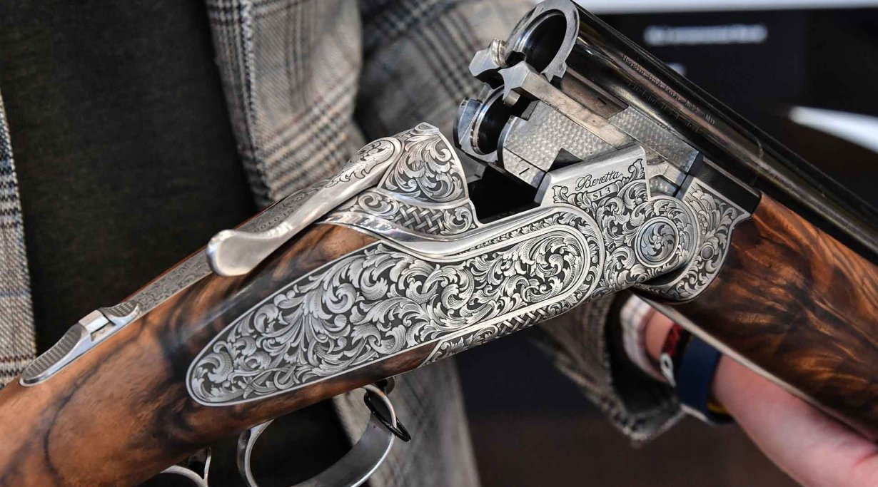Richly engraved receiver of the Beretta SL3 hunting over-under