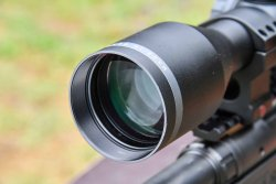 The objective lens of the Minox ZE 5.2 2-10x50 hunting riflescope