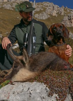 Satisfied hunter with chamois