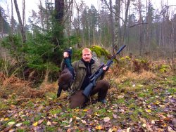 Hunter with capercaillie cock bird.