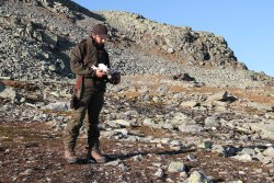 Hunter with Rock ptarmigan
