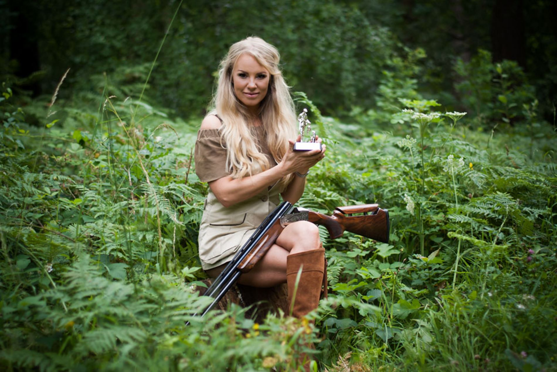 Rachel Carrie shooting with her rifle in the woods