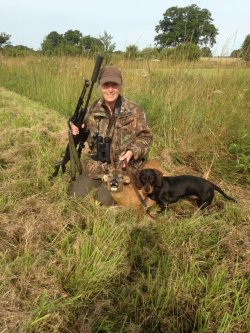 Deer stalker Audrey Watson with a roe buck and her teckel.