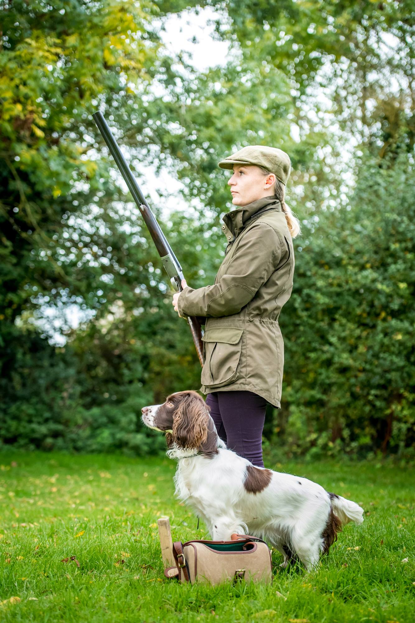 Louise Farmer with her dog and a 20bore shotgun