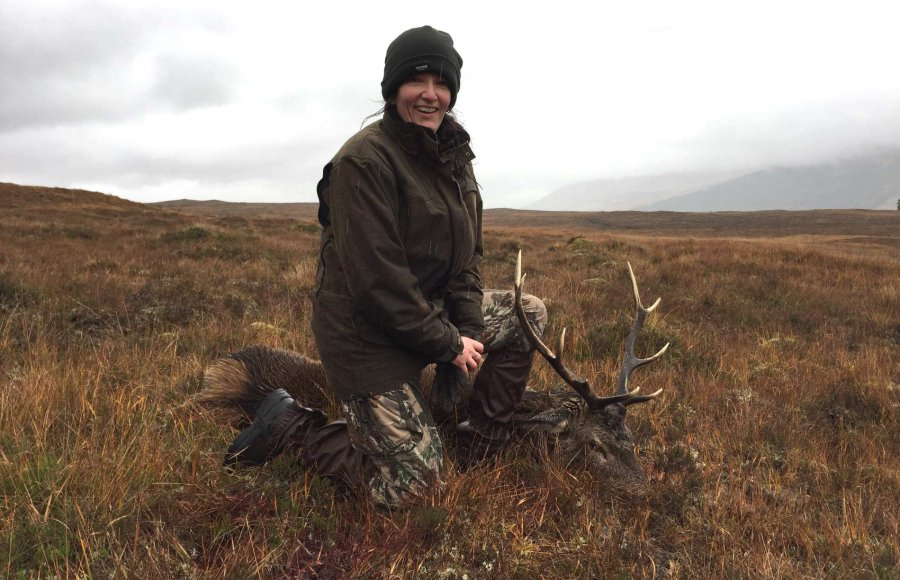 Lady hunter and a red stag