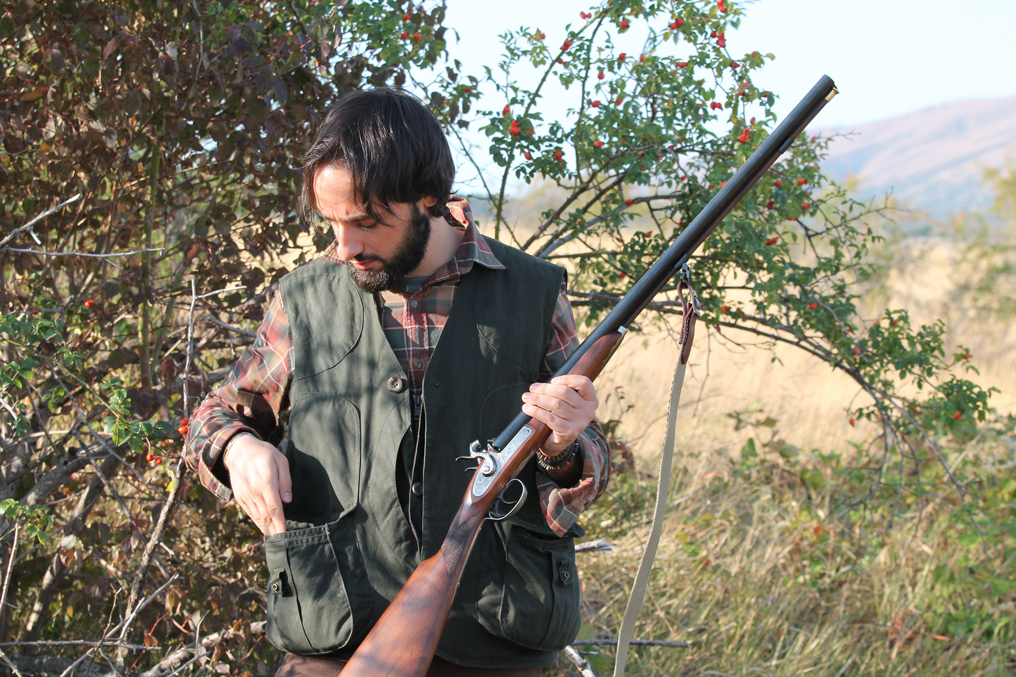The hunter in the woods with his shotgun, the Pedersoli Waterfowl 20-gauge