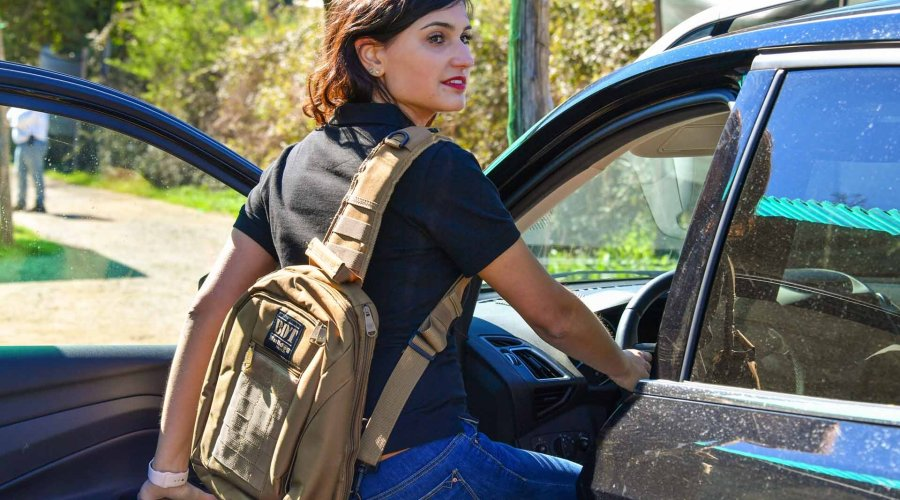 Girl wearing the Bulldog BDT Carry Sling Pack Small Tan pack