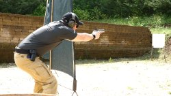 Shooter during a dynamic shooting training with Forcetek technical polo