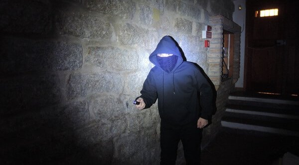 Intruder illuminated by the white light LED of an MFT Torch Backup tactical gunlight