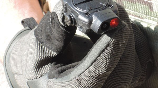 MFT Torch Backup tactical gunlight held by gloved hand