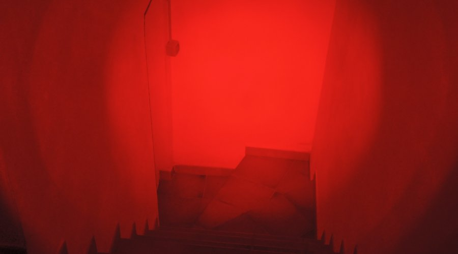 Corridor illuminated by the red navigation LED of the MFT Torch Backup tactical gunlight