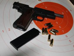 Pistol, ammunition .45 ACP and targets