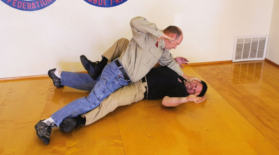 Self-defense sequence when the aggressori is sitting on the victim. Part six: legs are spread to generate maximum holding power
