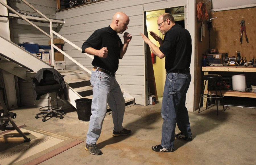 2 ready-to-fight men demonstrate the basics of self-defense