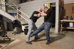 Close quarters combat : self defense demonstration between 2 men