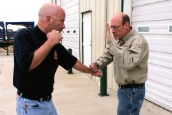 Demonstrated of the collar grip by two men
