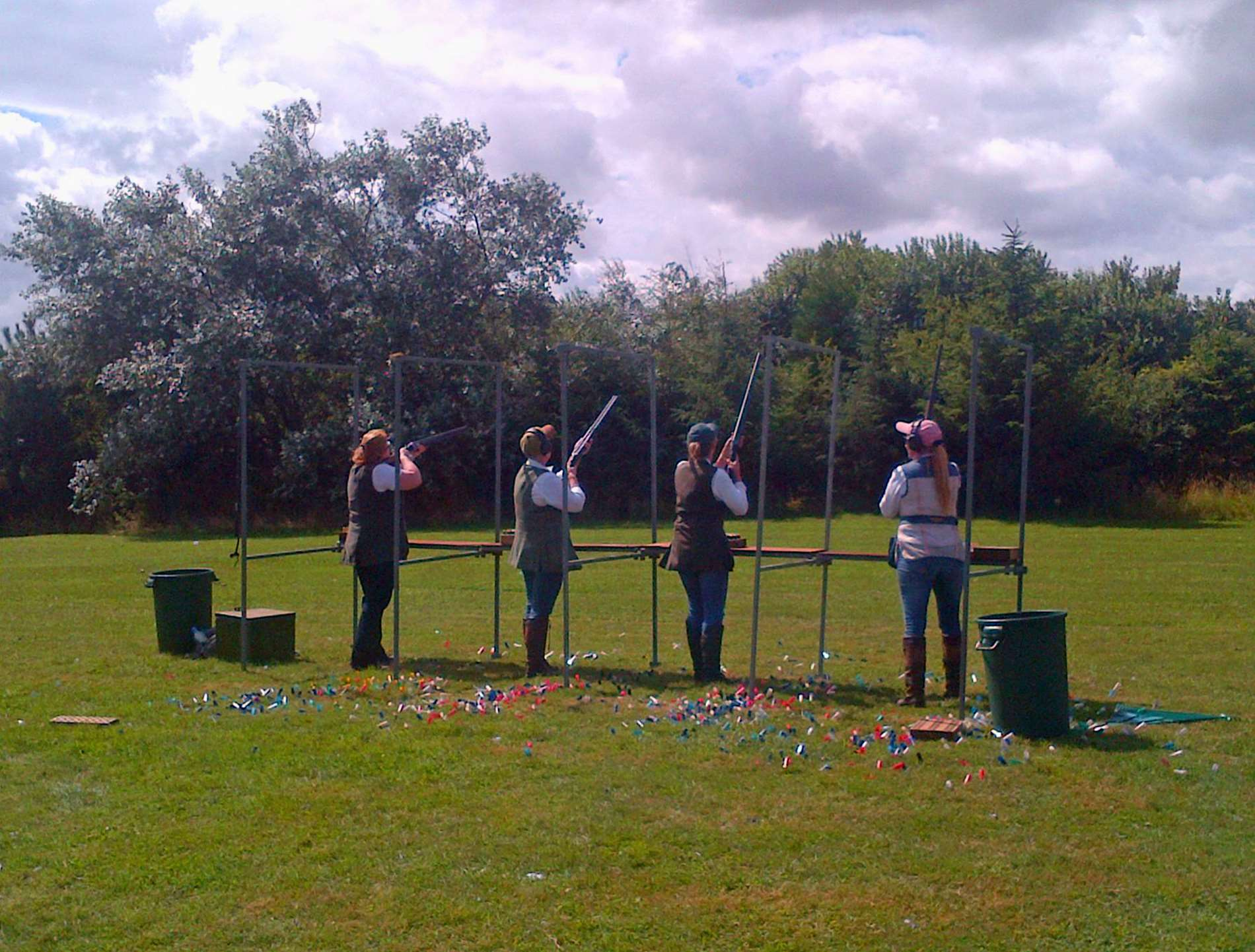 Girls shooting clay targets