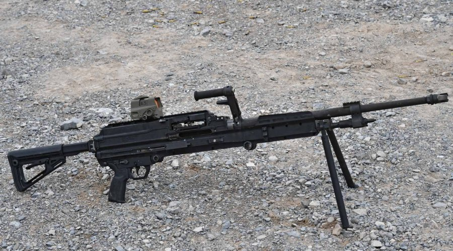 The new SIG Sauer belt-fed SLMAG Machinegun in .338NM with a Romeo 8T red dot sight was mounted on the top rail.