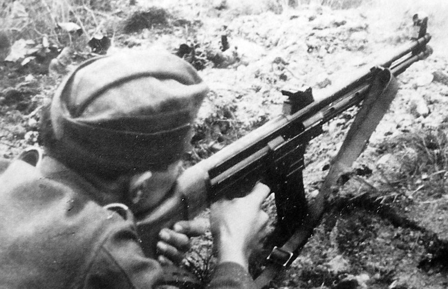 German soldier shooting with the Haenel Maschinenkarabiner Mkb.42(h).