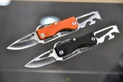 Maserin Shaped Citizen knives in black and orange handle.