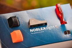 The Noblex sight C comes with two protective caps and a screwdriver