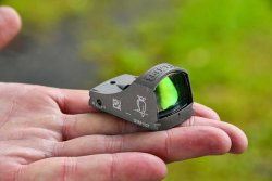 The Noblex sight C on a palm of a hand