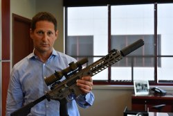 Ron Cohen, President and CEO, SIG SAUER, presents the new military rifle scope TANGO6 1-6X24 SDMR