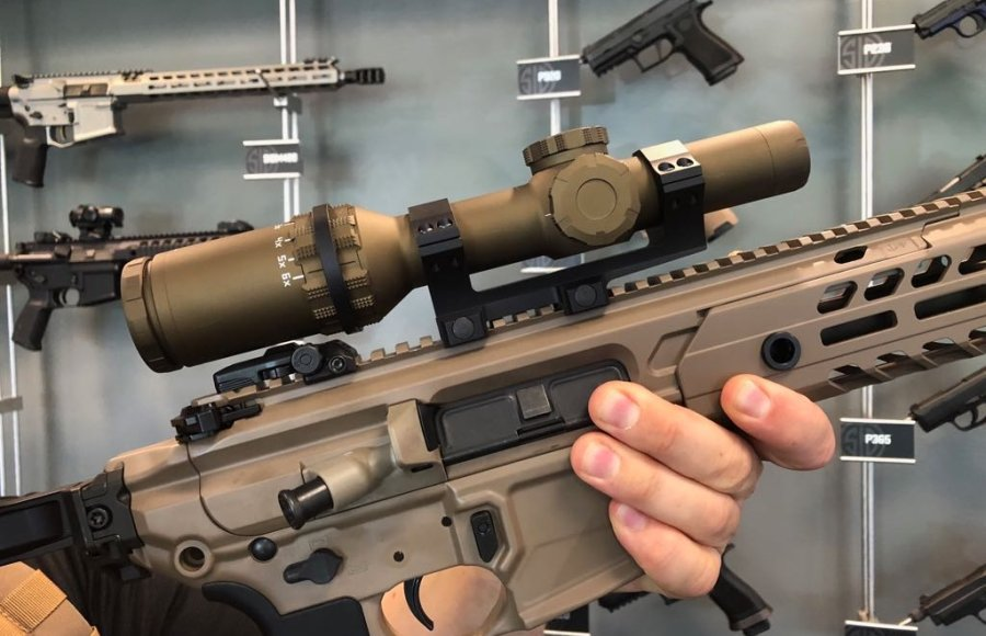The military riflescope TANGO6 1-6X24 SDMR mounted on a MCX Virtus semiautomatic rifle with suppressor.