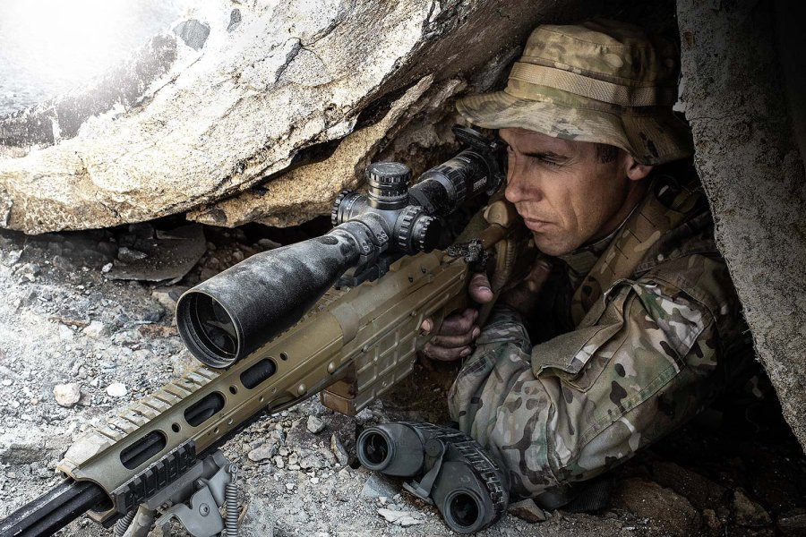 Sniper shooter with rifle with the mounted Steiner M5Xi 5 5-25x56 riflescope