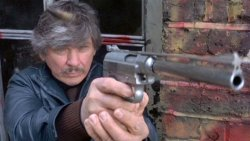 Charles Bronson in Death Wish 3 with the Wildey semi-auto pistol