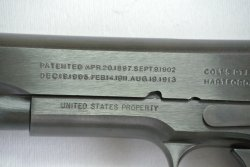 "The marking ""UNITED STATES PROPERTY"" on the slide os the WW1 Colt 1911 replica"