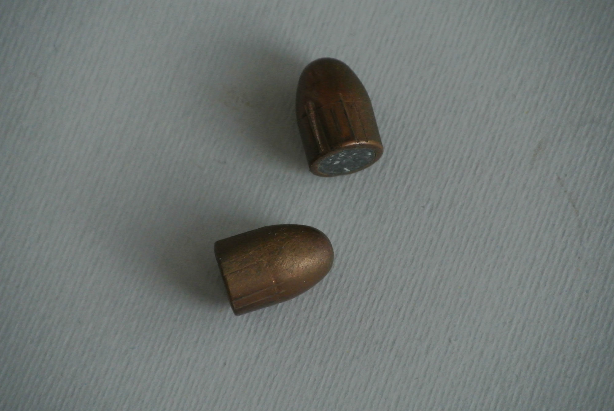 Two .45 ACP 226-grain lead round-nose bullets