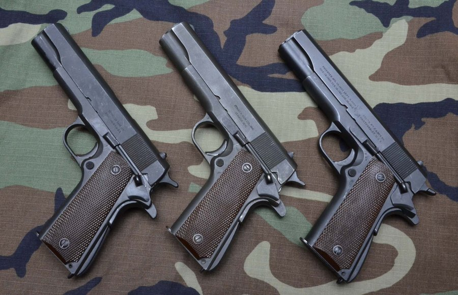 Three war-production 1911A1 pistols: Remington Rand (1944), Ithaca Gun Co. (1945) and Colt (1943).