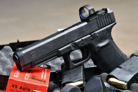 GLOCK G41 MOS pistol in caliber .45 Auto with reflex sights and magazine; ammo by GECO