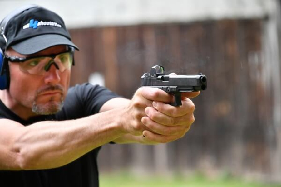 A sports shooter tests a GLOCK pistol in MOS configuration at the range
