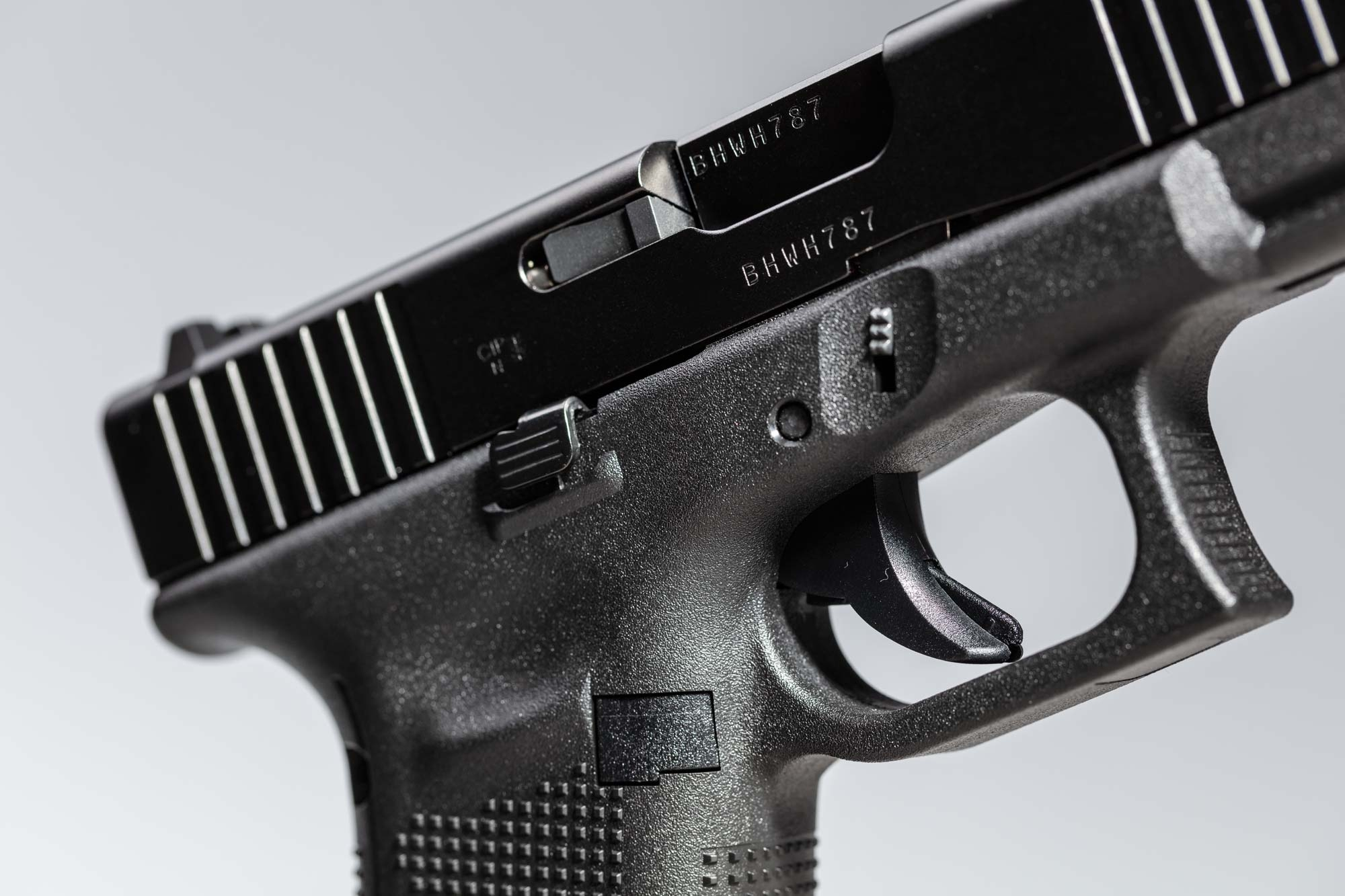 Close-up of the right side slide catch lever of the GLOCK 45 pistol